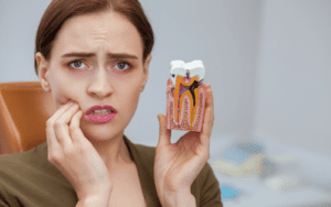 Woman holding model of decayed tooth