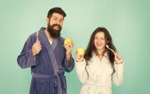 Couple with apples and toothbrushes